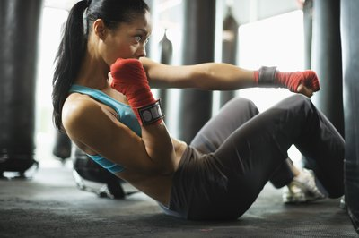 Modified crunches help build abs for boxers.