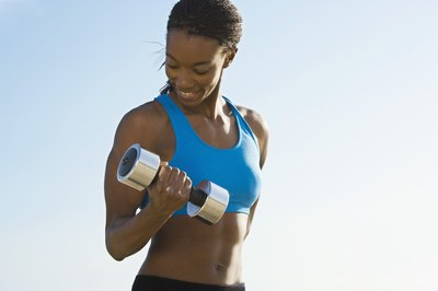 Dumbbell biceps curls will tone up the front of your upper arms.
