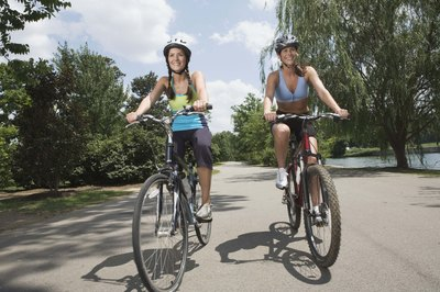 Biking with a friend allows you to chat and burn fat.