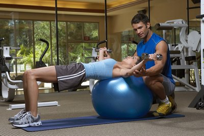 Chest flies are more challenging when done on a stability ball.
