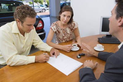 Car dealers take trade-ins with outstanding loans all of the time.