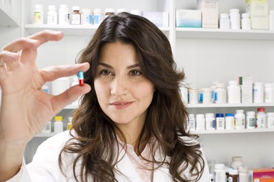 Pharmacy technicians fill prescriptions for the pharmacist.