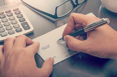 Beneficiaries can't cash checks made out to an estate.