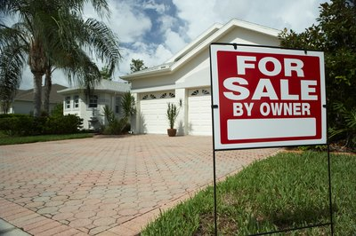 Can a House With a Mortgage Be Sold With Owner Financing?