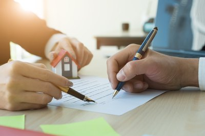 When Should You Sign a Trust Deed When Selling Your House?