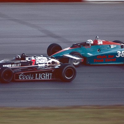 1984 IndyCars at Pocono Raceway w:Al Unser, Jr. car 7, w:Chet Fillip car 38