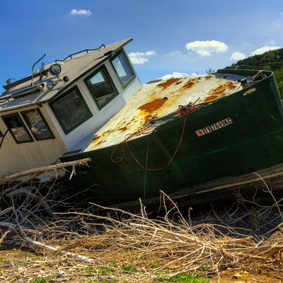 The 2011 Texas drought dried up much of Central Texas water ways. This boat was left to sit in the middle of what is normally a branch of Lake Travis, part of the Colorado River.