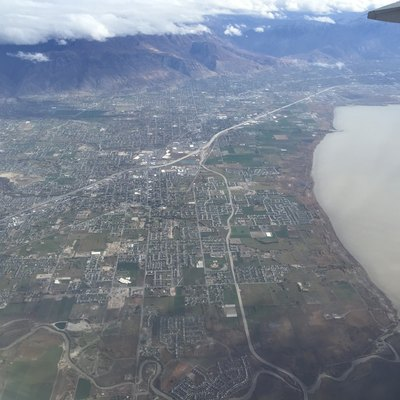 View from an airplane of the cities of Lehi, American Fork, Pleasant Grove, Lindon and Orem, Utah along Interstate 15 and the northeast shore of Utah Lake