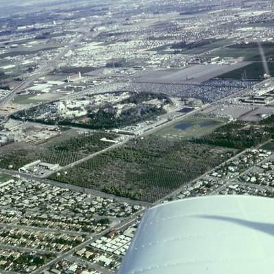Archive Aerial photo of Anaheim, California including Disneyland, the Disneyland Hotel, and the monorail system. The Disneyland Heliport, surrounding orange groves, Santa Ana Freeway (now I-5) and the Melodyland Theater