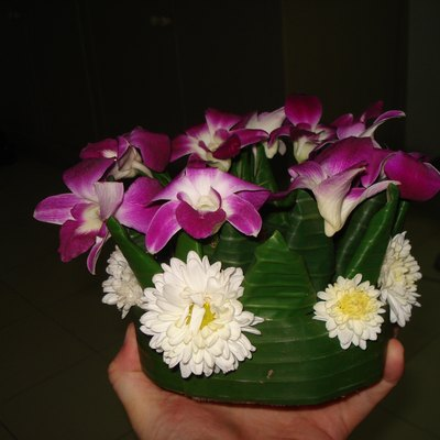 A Loi Krathong made from trunk of banana tree, banana leaves and flowers, held together with pins.