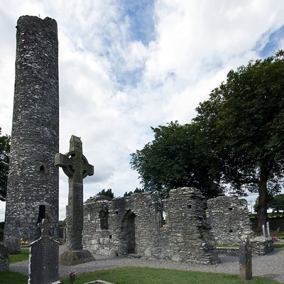 A high cross and round tower at Monasterboice, Ireland