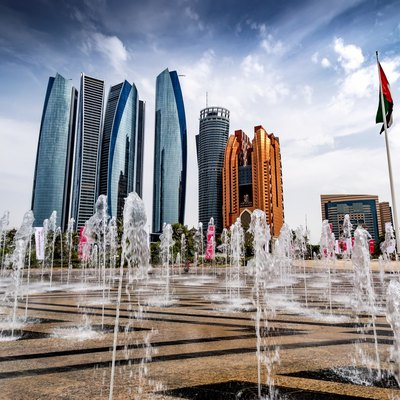 Abu Dhabi (US /ˈɑːbuː ˈdɑːbi/, UK /ˈæbuː ˈdɑːbi/; Arabic: أبو ظبي‎ Abū Ẓabī Emirati pronunciation [ɐˈbuˈðˤɑbi]) is the capital and the second most populous city in the United Arab Emirates (the most populous being Dubai), and also capital of Abu Dhabi emirate, the largest of the UAE's seven member emirates. Abu Dhabi lies on a T-shaped island jutting into the Persian Gulf from the central western coast. The city proper had a population of 1.5 million in 2014. ( Source : Wiki )