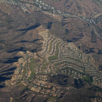 Aerial view of Calabasas, California... looks like the intersection of Las Virgenes and the 101, facing northwest