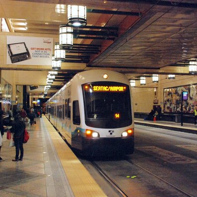 A Link light rail train at Westlake station, starting to depart for Sea-Tac Airport.