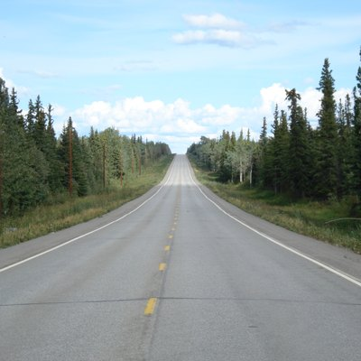 Mile 1,337 on the Alaska Highway (between Tok and Delta Junction) near Dot Lake. This is the roughly eastbound view (towards Tok). Power lines, trees, and terrain are visible.