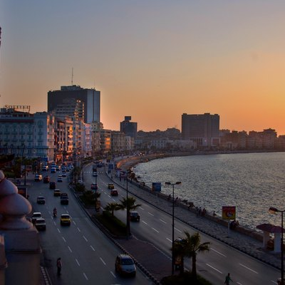 Sunset illuminates the promenade of Alexandria's waterfront. A welcome change from the heat and dust of Cairo.