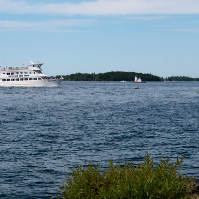 View across Saint Lawrence River from Alexandria Bay, NY. On the river the Island Duchess by Uncle Sam Boat tours, bringing visitors to Boldt Castle.