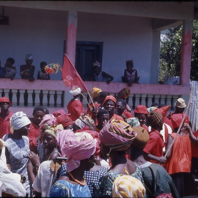 All People's Congress (APC) Political Rally in Kabala, Sierra Leone (West Africa) 1968. Red is the colour of the All People's Congress (A.P.C); they were demonstrating in front of houses belonging to people who supported the rival Sierra Leone People's Party (S.L.P.P.). Photo taken in 1968.