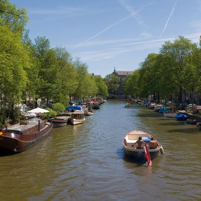 A panorama of 4 segments of an Amsterdam Canal in summer.
