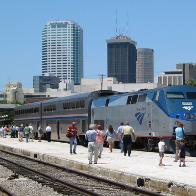With the skyline of downtown Tampa as a backdrop, an Amtrak train sits along the stub-end platform behind Tampa Union Station. Special train P974 brought Superliner equipment for display at festivities for National Train Day 2009.