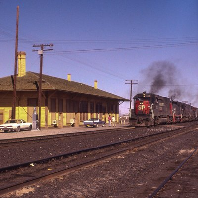 An SP westbound passing the old Deming NM depot.