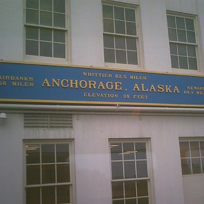 Sign near the train platform outside of the Alaska Railroad station in Anchorage. Lists distances via rail to other Alaskan communities.