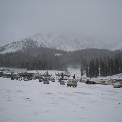 The parking lot at Arapahoe Basin on October 29, 2004 (A-Basin's opening day) at 4:03 PM (local time). Alas, this is only a thumbnail; I didn't keep the original version. The bottom of the main ski lift is visible.