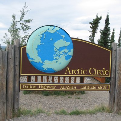 This is a road sign marking the location of the Arctic Circle along the Dalton Highway.