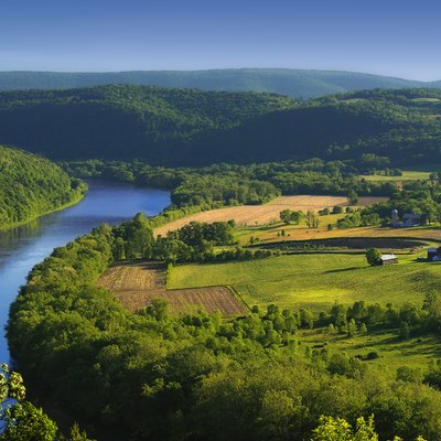 The Susquehanna River, Asylum Township, Bradford County, as seen from the Marie Antoinette Lookout off of US Route 6 near Wyalusing in Pennsylvania. Visible from here is the French Azilum Historic Site, where some Revolution-fleeing French aristocrats settled in 1793. It was said that Marie Antoinette planned to settle in a house across the river from the lookout which was allegedly built for her. The marker reads: A settlement of French royalists, who fled the French Revolution in 1793, was established in the valley directly opposite this marker. It was laid out and settled under the direction of Viscount de Noailles and Marquis Antoine Omer Talon. It was hoped that Queen Marie Antoinette might here find safety. Marie Antoinette Lookout, Route 6, Wyalusing, PA.