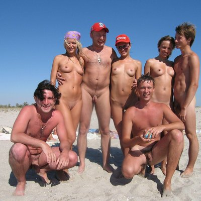 Posing for the camera. Group nude on a Crimean beach.