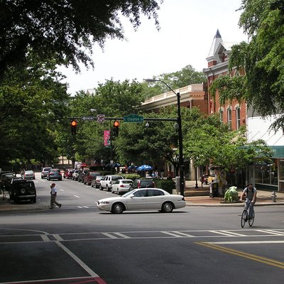 Photograph taken by Richard Chambers of a street scene in Athens. Image taken on Sunday morning, May 11, 2008. This image taken on the standing on the sidewalk of College Avenue near where it intersects with Clayton Street. You can see the arches onto North Campus of the University of Georgia in the middle of the background. You can also see one of the Bulldog statues that were set up around downtown at several locations. The university sports teams such as football and basketball are known as the Georgia Bulldogs.