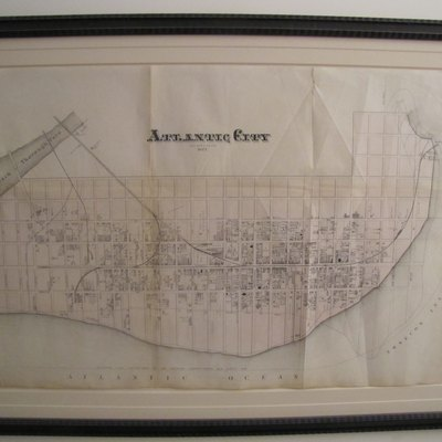 A map of Atlantic City from 1877 - picture of the framed original (which I own). Of special interest is a notation of the 1852 coastline, and the boardwalk to the U.S. Hotel.
