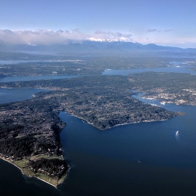 Aerial view of Bainbridge Island from the southeast, showing the Bainbridge Island ferry making the first of two turns to bring it into Eagle Harbor