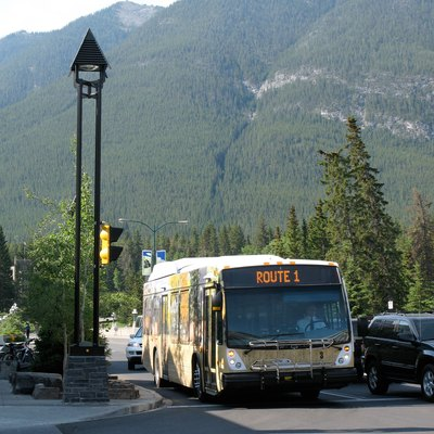 A local bus operated by Roam, running a route 1 service along Banff Avenue in Banff, Alberta, Canada.