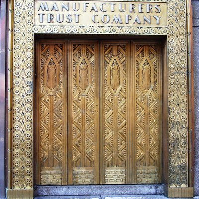 A brass door, formerly the entrance to a bank, in the New Yorker Hotel on Eighth Avenue between 34th and 35th Streets in midtown Manhattan, New York City.
