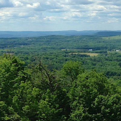 Panorama of the Warwick Valley, photo taken near the Bellvale Farms Creamery. In the distance, from the south, are the Kittatinny Mountains and the High Point Monument in New Jersey, and the Shawangunk Ridge in New York. In front of these distant ridges, are the peaks Mount Adam and Mount Eve in the Black Dirt Region.