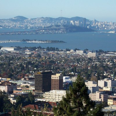 Downtown Berkeley. The Oakland - San Francisco Bay Bridge and the San Francisco downtown can be seen in the background. PowerBar headquarters are visible in Downtown Berkeley. Looking from the Berkeley Hills westward. California, USA.