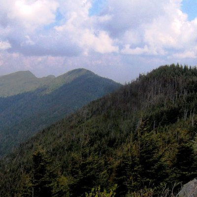 The crest of the north-central Black Mountains in Yancey County, North Carolina, in the southeastern United States. From left to right: Cattail Peak, Balsam Cone, and Big Tom. Part of Potato Hill can be seen just over the ridge connecting Cattail and Balsam Cone. The view is north from Mount Craig.