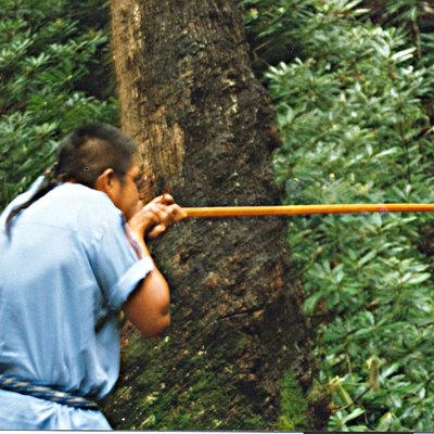 Demo of Blow Gun in Oconaluftee Indian village, Cherokee, NC Photo by Jan Kronsell, 2000