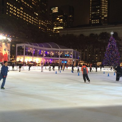 The Rink at Bank of America Winter Village, with the rear of the main building of the New York Public Library in the background