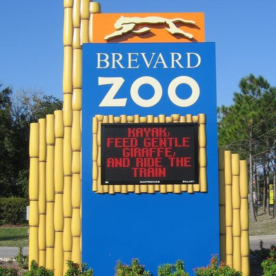 Brevard Zoo Monument Sign Located At Road Entrance To Museum On Murrell Road At Intersection With Wickham Road, Melbourne, Florida, United States.