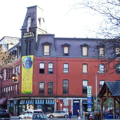 Brooks House, on Main Street in Brattleboro, Vermont, was built in 1871 as an 80-room luxury hotel to replace a previous hotel on the site which was destroyed by fire. On April 17, 2011, the current building was seriously damaged by fire, and efforts to repair the damage and renovate the building were continuing a year later, when the owner announced he was selling the building to a local consortium, who could better raise the necessary funds. The building is on the National Register of Historic Places and is located within the Brattleboro Downtown Historic District. (Sources: