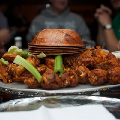 A bowl of chicken (Buffalo) wings and celery.