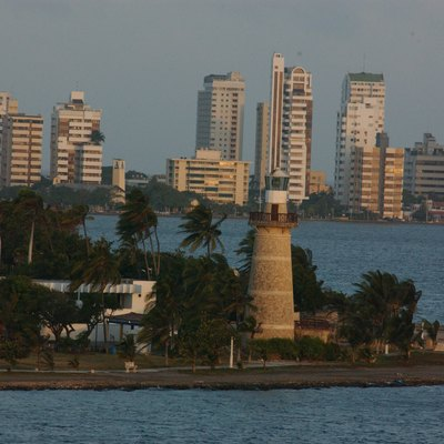 Lighthouse Was Built In 1973. It Lies On A Peninsula Jutting Into The Harbor And Lies Within An Upscale Cartagena Neighborhood.
