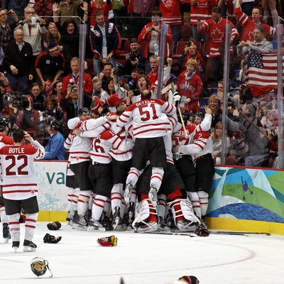 The Canadian Men'S Ice Hockey Team Celebrates Winning The Gold Medal In Overtime Over The United States During The 2010 Winter Olympics