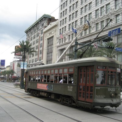 Canal Street, New Orleans. 1920s Pearly Thomas streetcar 922 heads out past the Maison Blanche Building.