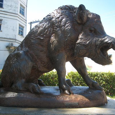 A cast metal statue of a wild boar made by the Fonderies du Val d'Osne, France, in a square in Maceió, Alagoas, Brazil.
