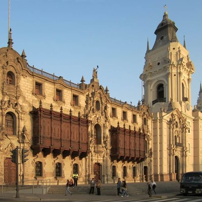The Archipishop's Palace and Cathedral of Lima stand on the east side of the Plaza de Armas in Lima, Peru.