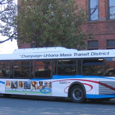 Champaign-Urbana Mass Transit District New Flyer D40LF bus 0320 next to the Champaign County Courthouse