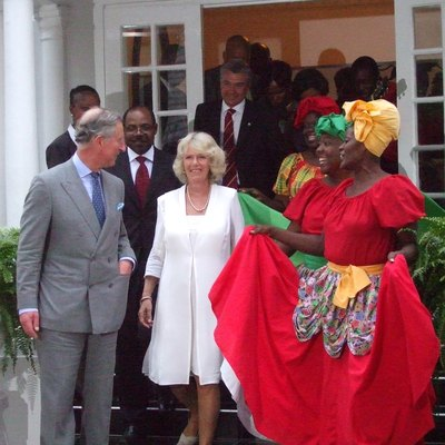 Photograph of Prince Charles and Camilla Parker Bowles. They were on an official visit to Jamaica and attended a reception at the Half Moon Hotel.